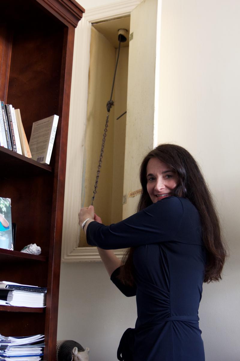 Dean Elissa Heil pulls the bell